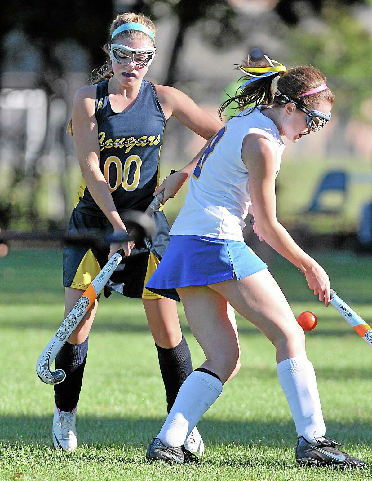 Mercy's Catie McAuliffe attempts to move the ball around Haddam-Killingworth's Julia Babbitt in the second half Monday afternoon in Middletown. H-K defeated the Tigers 2-0.