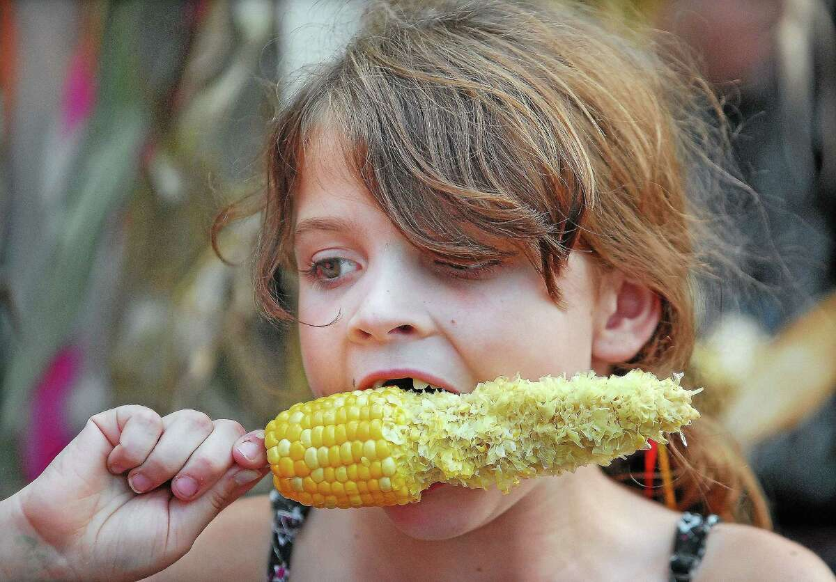 Sara O'Malley, of Durham, works her way through a corn on the cob at the 2012 Durham Fair.