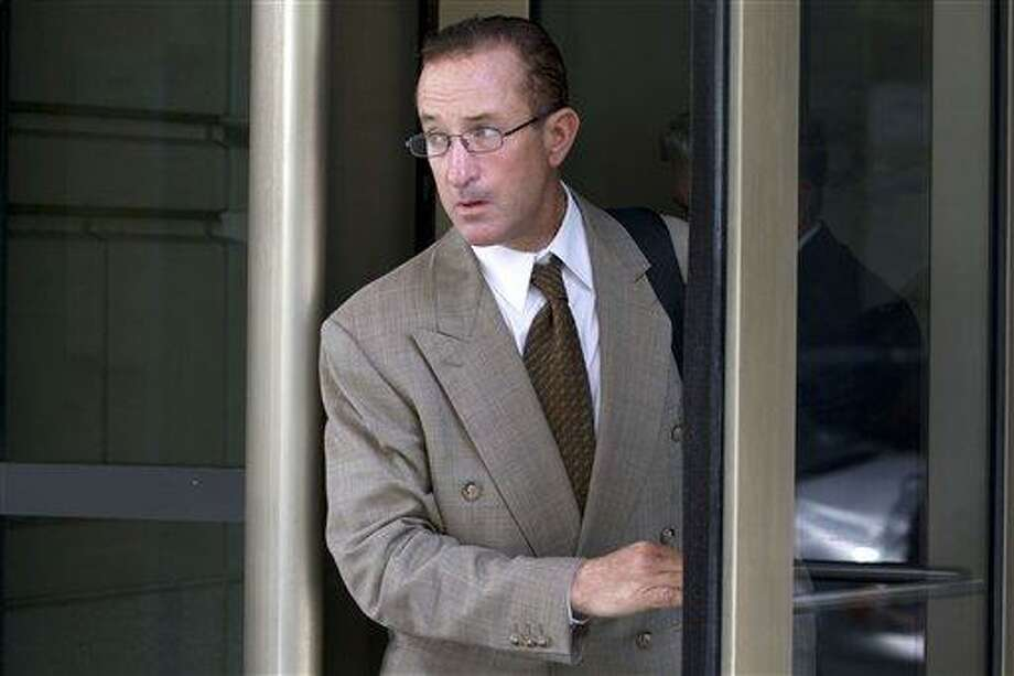 Former Major League baseball pitcher Roger Clemens' former trainer Brian McNamee leaves federal court in Washington, Wednesday, May 16, 2012, after testifying in Clemens perjury trial. (AP Photo/Jacquelyn Martin) Photo: AP / AP