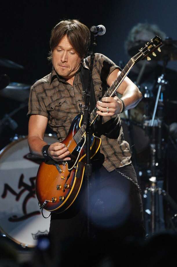 Keith Urban performs during the CMT Music Awards June 16 in Nashville, Tenn. Associated Press Photo: AP / AP