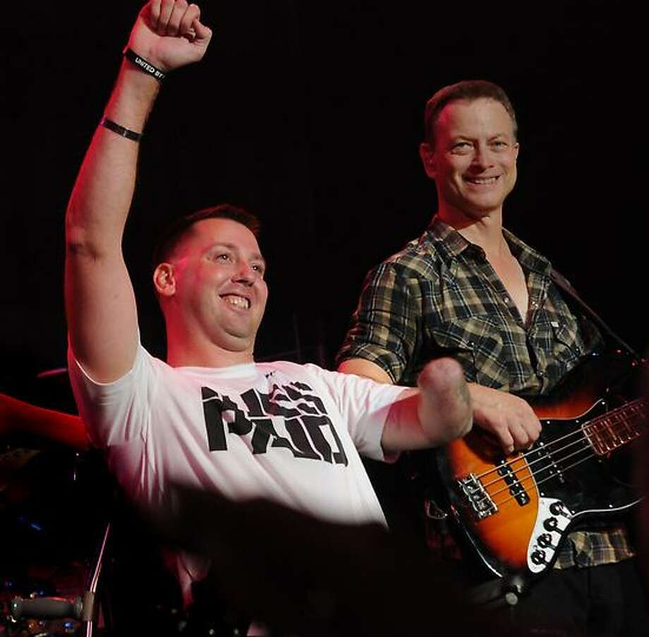 Gary Sinise, right, with veteran Adam Keys, left, at the benefit concert at State Theater in Easton, Penn. Photo by Melanie Stengel/New Haven Register Photo: New Haven Register / ©PMelanoie Stengel/ New Haven Register