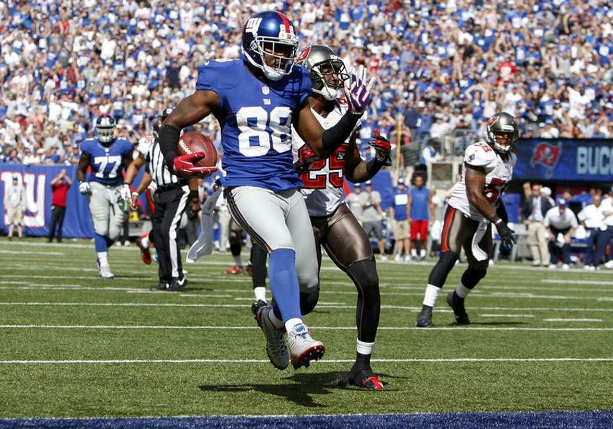 Sep 16, 2012; East Rutherford, NJ, USA; New York Giants wide receiver Hakeem Nicks (88) scores a touchdown against the Tampa Bay Buccaneers during the game at MetLife Stadium. Mandatory Credit: Chris Faytok/THE STAR-LEDGER via US PRESSWIRE