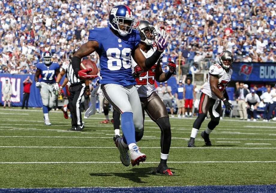 Sep 16, 2012; East Rutherford, NJ, USA; New York Giants wide receiver Hakeem Nicks (88) scores a touchdown against the Tampa Bay Buccaneers during the game at MetLife Stadium.  Mandatory Credit: Chris Faytok/THE STAR-LEDGER via US PRESSWIRE Photo: The Star-Ledger-US PRESSWIRE / The Star-Ledger