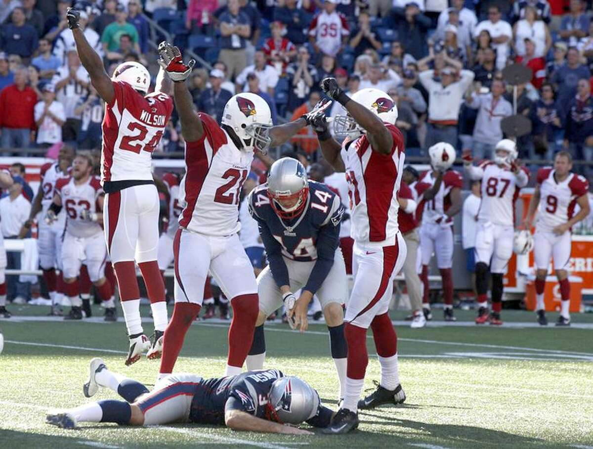 Sep 16, 2012; Foxborough, MA, USA; The Arizona Cardinals celebrate as New England Patriots kicker Stephen Gostkowski (3) lays on the ground after missing a field goal in the last seconds of play during the second half at Gillette Stadium. The Arizona Cardinals defeated the New England Patriots 20-18. Mandatory Credit: David Butler II-US PRESSWIRE
