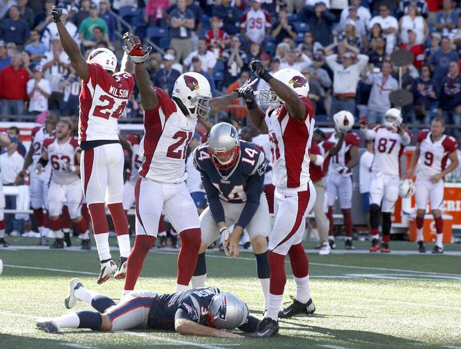 Sep 16, 2012; Foxborough, MA, USA; The Arizona Cardinals celebrate as New England Patriots kicker Stephen Gostkowski (3) lays on the ground after missing a field goal in the last seconds of play during the second half at Gillette Stadium. The Arizona Cardinals defeated the New England Patriots 20-18. Mandatory Credit: David Butler II-US PRESSWIRE Photo: US PRESSWIRE / David Butler II