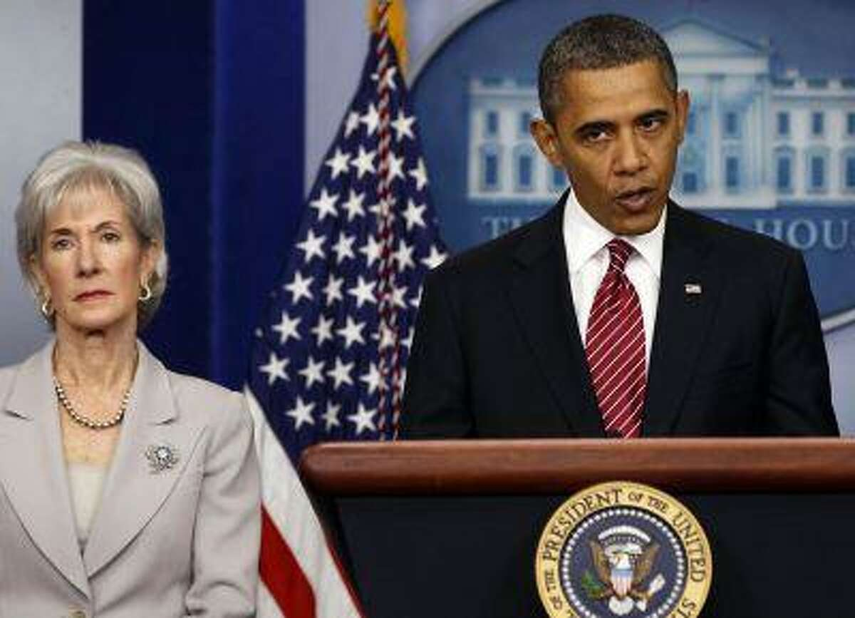 President Barack Obama makes a statement next to Secretary of HHS Kathleen Sebelius about contraceptive care funding in the press room of the White House in Washington, February 10, 2012. REUTERS/Larry Downing