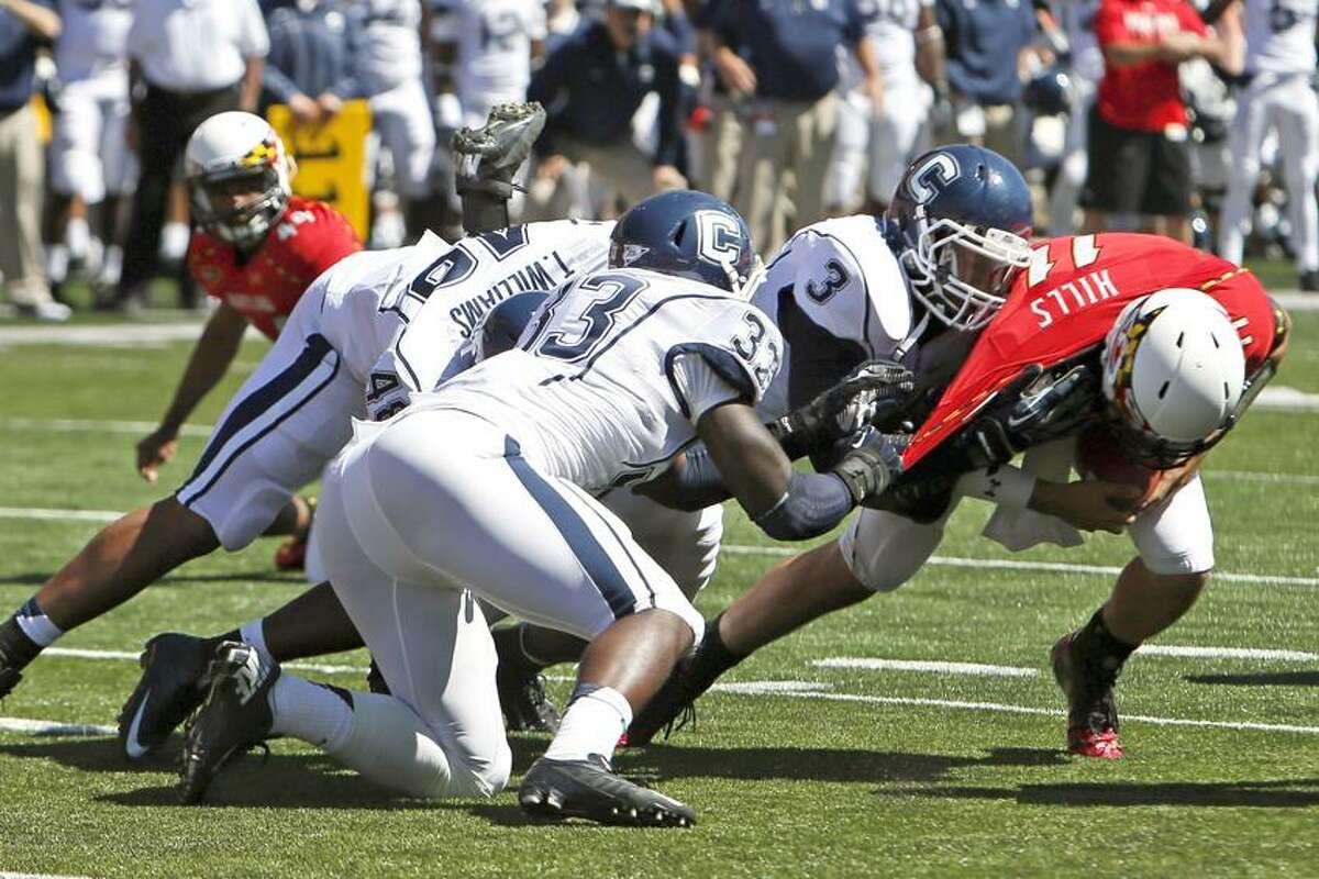 September 15, 2012; College Park, MD, USA; Connecticut Huskies linebacker Sio Moore (3) sacks Maryland Terrapins quarterback Perry Hills (11) at Byrd Stadium. Mandatory Credit: Mitch Stringer-US PRESSWIRE