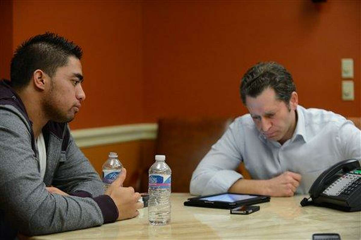 In a photo provided by ESPN, Notre Dame linebacker Manti Te'o listens during an interview with ESPN's Jeremy Schaap, right, on Friday, Jan. 18, 2013, in Bradenton, Fla. ESPN says Te'o maintains he was never involved in creating the dead girlfriend hoax. He said in the off-camera interview: