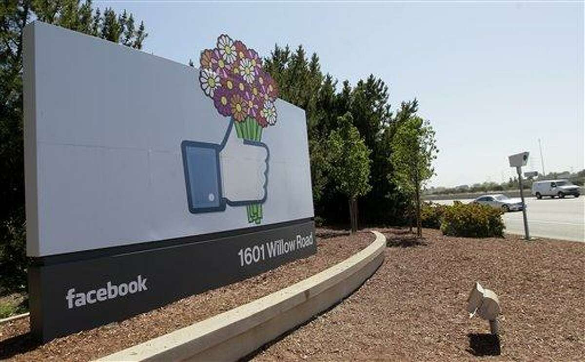 A sign is shown at the Facebook campus May 11 in Menlo Park, Calif. Half of Americans think Facebook is a passing fad, according to the results of an Associated Press-CNBC poll. And, in the run-up to the social network's initial public offering of stock, half of Americans also say the social network's asking price is too high. Associated Press