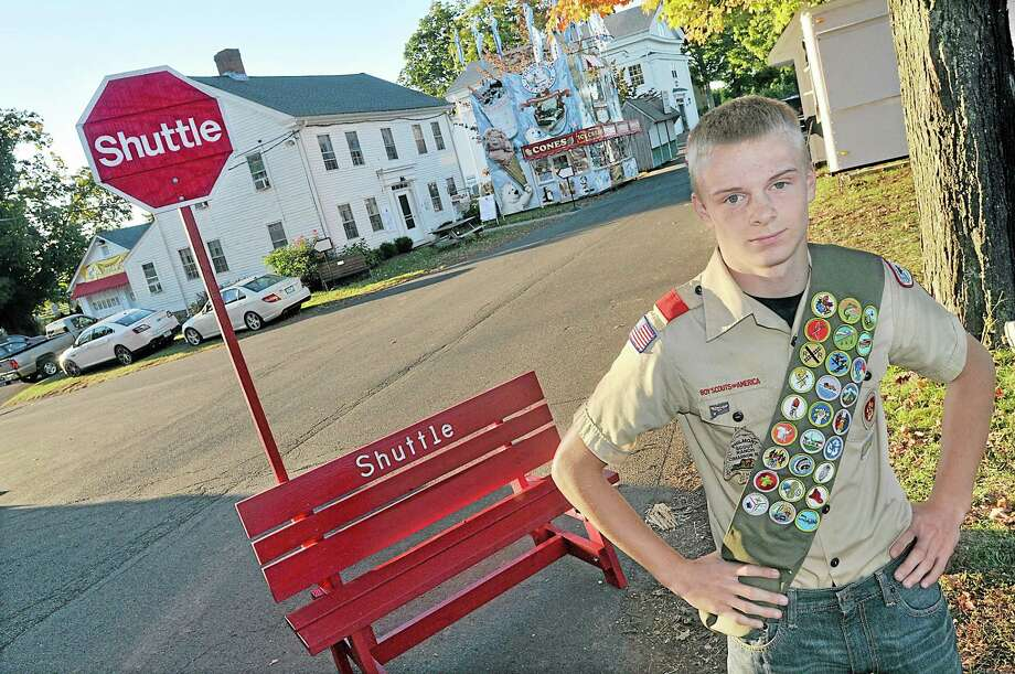 Durham Life Scout Andrew Van Steenbergen, 16, of Troop 27, constructed 12 brightly painted benches to be used at six different shuttle stops at the Durham Fair for his Eagle Scout Service Project. Van Steenbergen, a Coginchaug junior, has earned 28 merit badges. Photo: Catherine Avalone — The Middletown Press  / TheMiddletownPress