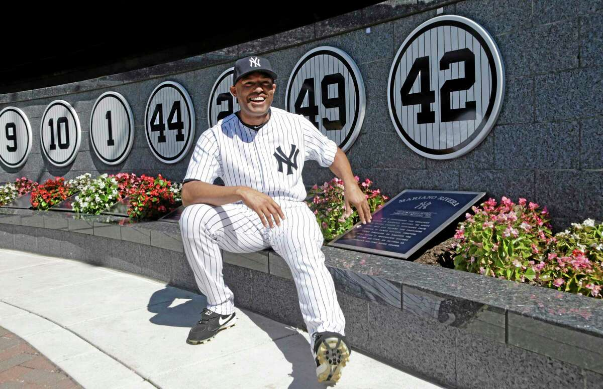 Mariano Rivera (42) poses with a plaque showing his retired number in Monument Park.