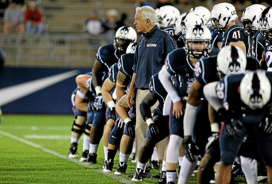 UConn head coach Paul Pasqualoni, center, watches his team run drills before Saturday's game against Michigan at Rentschler Field. Photo: Jessica Hill — The Associated Press  / FR125654 AP