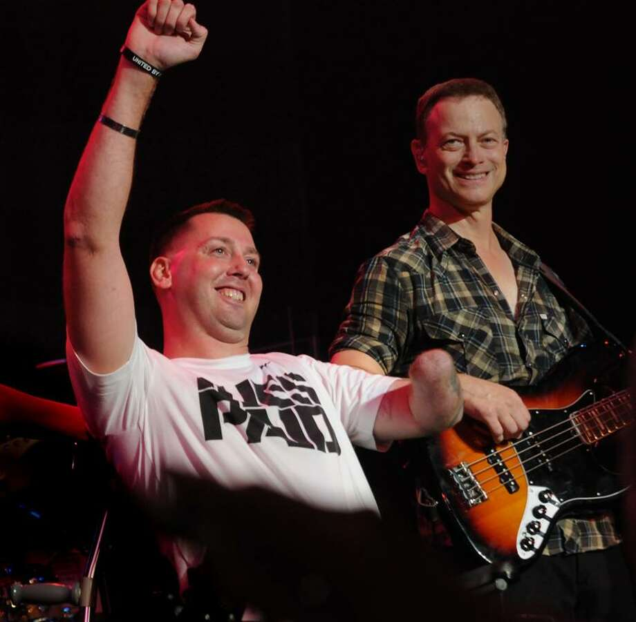 Gary Sinise benefit   ay the State Theater in Easton PA. . Veteran, Adam Keys  walks on stage. Photo by Melanie Stengel/ New Haven Register Photo: New Haven Register / ©PMelanoie Stengel/ New Haven Register