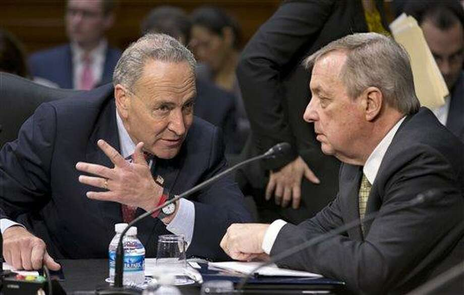 Senate Judiciary Committee members Sen. Chuck Schumer, D-N.Y., left, and Sen. Richard Durbin, D-Ill. confer on Capitol Hill in Washington, Monday, May 20, 2013, as the committee assembled to work on a landmark immigration bill to secure the border and offer citizenship to millions. The panel is aiming to pass the legislation out of committee this week, setting up a high-stakes debate on the Senate floor.  (AP Photo/J. Scott Applewhite) Photo: AP / AP