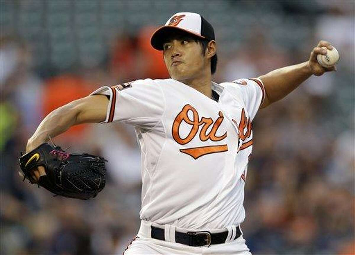 Baltimore Orioles starting pitcher Wei-Yin Chen, of Taiwan, throws to the New York Yankees in the first inning ofa baseball game in Baltimore, Tuesday, May 15, 2012. Baltimore won 5-2. (AP Photo/Patrick Semansky)