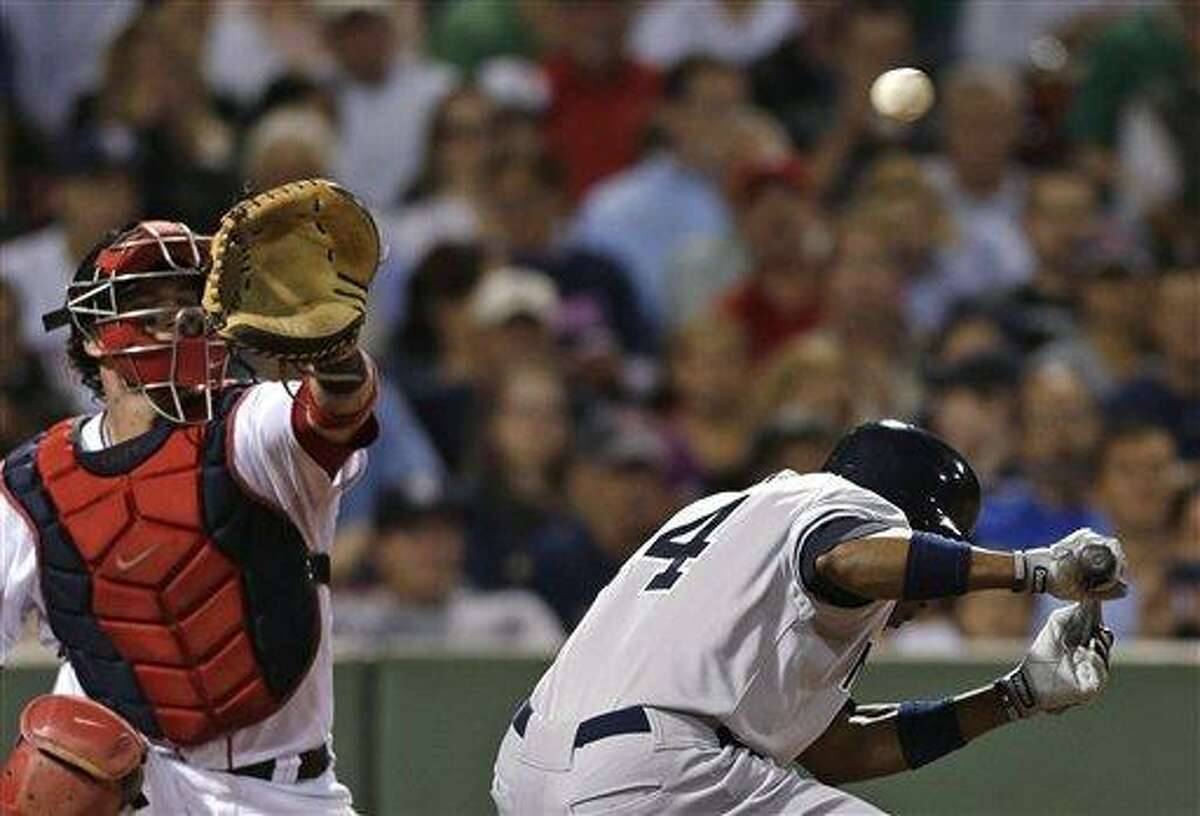 New York Yankees' Curtis Granderson ducks out of the way of a pitch by Boston Red Sox's Felix Doubront as catcher Jarrod Saltalamacchia reaches for the ball in the seventh inning of a baseball game, Thursday, Sept. 13, 2012, at Fenway Park in Boston. (AP Photo/Charles Krupa)