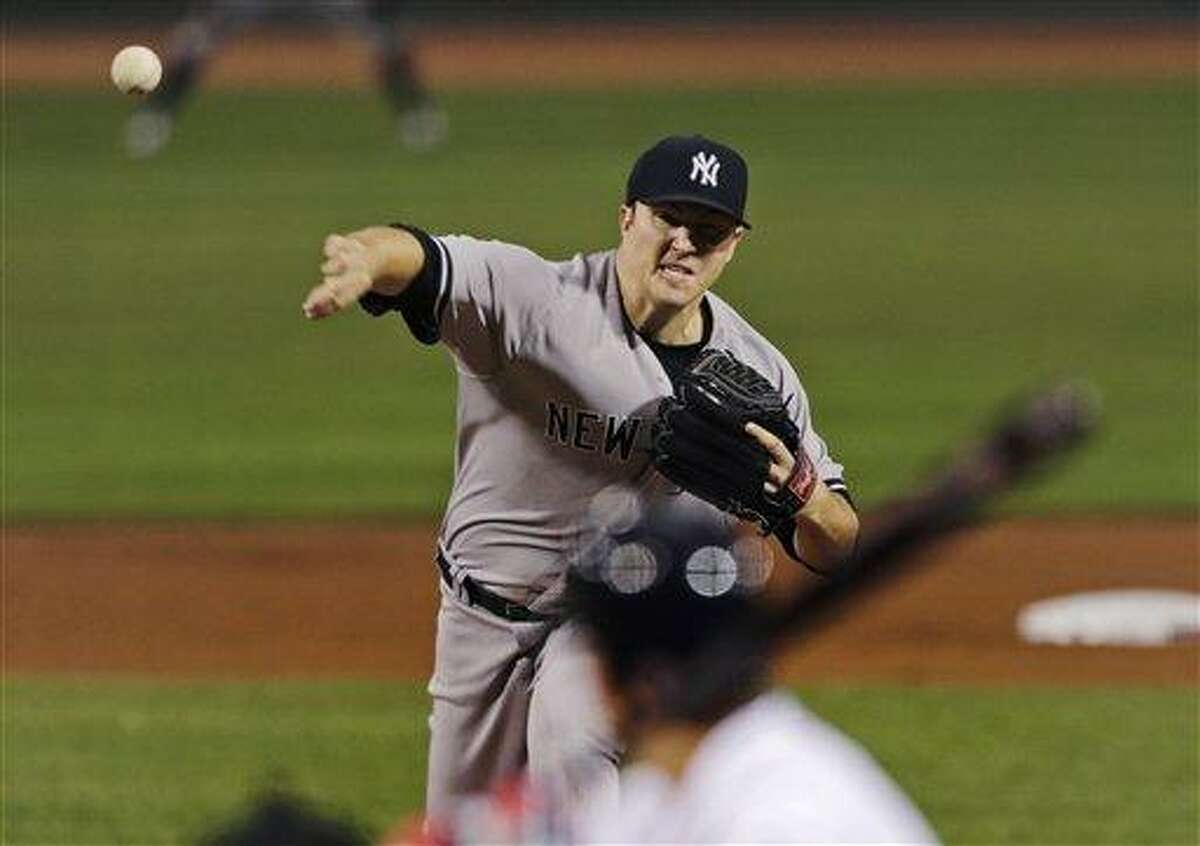 New York Yankees starting pitcher Phil Hughes delivers in the first inning of a baseball game against the Boston Red Sox, Thursday, Sept. 13, 2012, at Fenway Park in Boston. Hughes allowed no runs and five hits, and struck out seven, before being removed in the eighth inning. (AP Photo/Charles Krupa)