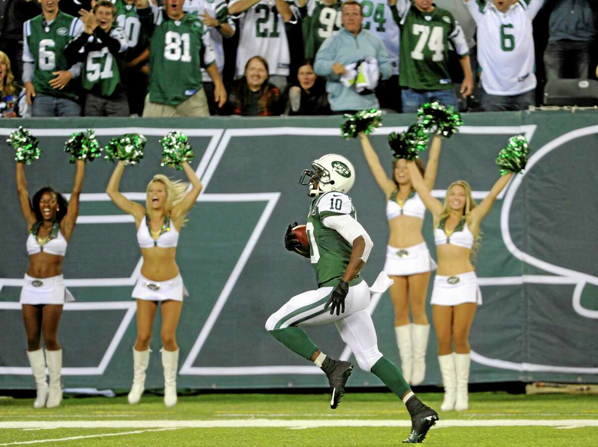 Santonio Holmes heads to the end zone on a touchdown reception against the Bills on Sunday.