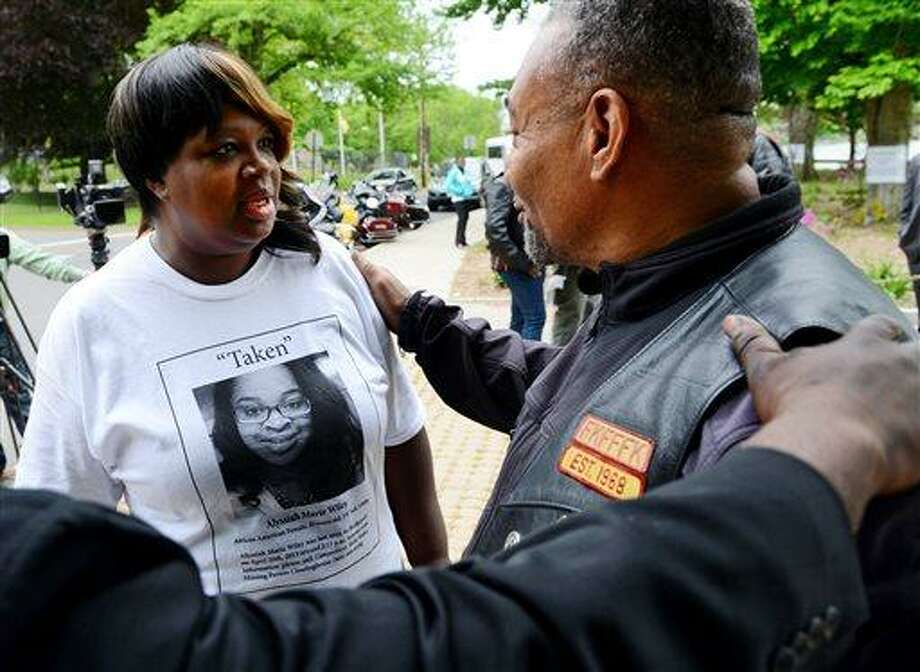 """Willis """"Snookie"""" Ragins, right, comforts Corrinna Martin before the start of a procession to remember Martin's daughter and murder victim Alyssiah Marie Wiley at Beardsley Park in Bridgeport, Conn., on Saturday May 18, 2013. Wiley, an Eastern Connecticut State University student, disappeared almost a month ago, authorities on Saturday identified her remains and charged a Bridgeport man in her death. (AP Photo/The Connecticut Post, Christian Abraham) Photo: AP / Connecticut Post"""