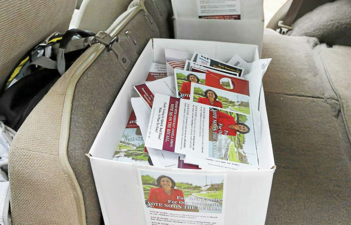 Campaign leaflets fill a box in the car of a campaign volunteer packing up before vacating a canvassing headquarters for Democratic state Sen. Angela Giron, one day after a recall vote which Giron lost, in Pueblo, Colo., Wednesday Sept. 11, 2013. Two Colorado state lawmakers who backed gun-control measures in the aftermath of the mass shootings in Colorado and Connecticut last year were ousted Tuesday in recall elections. (AP Photo/Brennan Linsley)