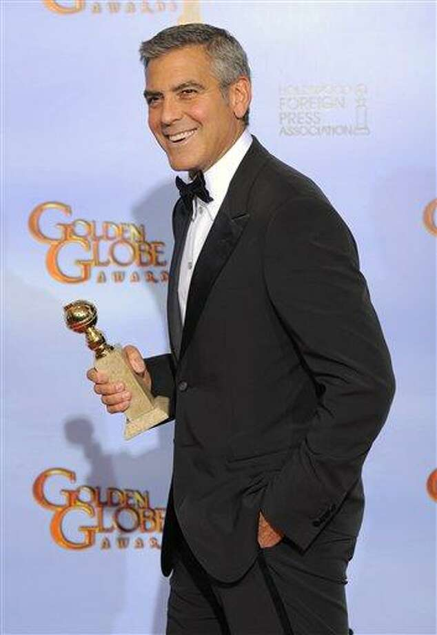 "Actor George Clooney poses backstage with the award for Best Actor in a Motion Picture Drama for the film ""The Descendants"" during the 69th Annual Golden Globe Awards Sunday, in Los Angeles. Associated Press Photo: AP / Copyright 2012 The Associated Press. All rights reserved. This material may not be published, broadcast, rewritten or redistributed."
