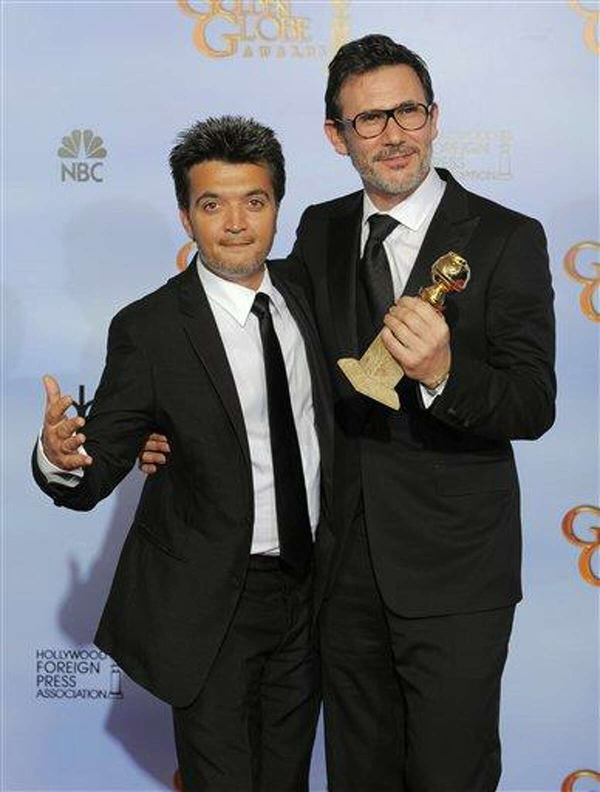 Thomas Langmann, left, and Michel Hazanavicius pose backstage with the award for Best Motion Picture - Comedy or Musical for the film