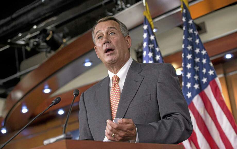 Speaker of the House John Boehner, R-Ohio, talks to reporters about the looming deadline to fund the government and the fight among House Republicans, on Capitol Hill in Washington, Thursday, Sept. 19, 2013. House Republicans vowed Wednesday to pass legislation that would prevent a partial government shutdown and avoid a historic national default while simultaneously canceling out President Barack Obama's health care overhaul, inaugurating a new round of political brinkmanship as critical deadlines approach. (AP Photo/J. Scott Applewhite) Photo: AP / AP
