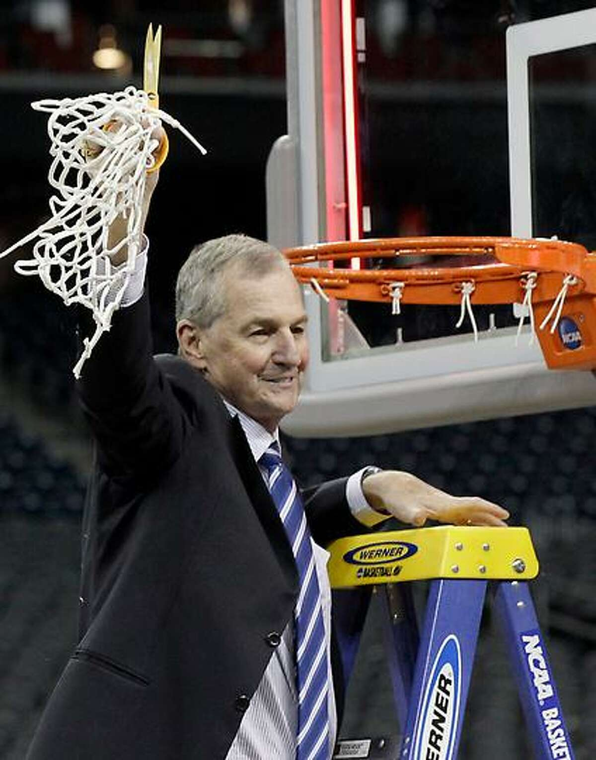 Connecticut head coach Jim Calhoun holds the net after his team won the men's NCAA Final Four college basketball championship game against Butler 53-41 Monday, April 4, 2011, in Houston. (AP Photo/David J. Phillip)