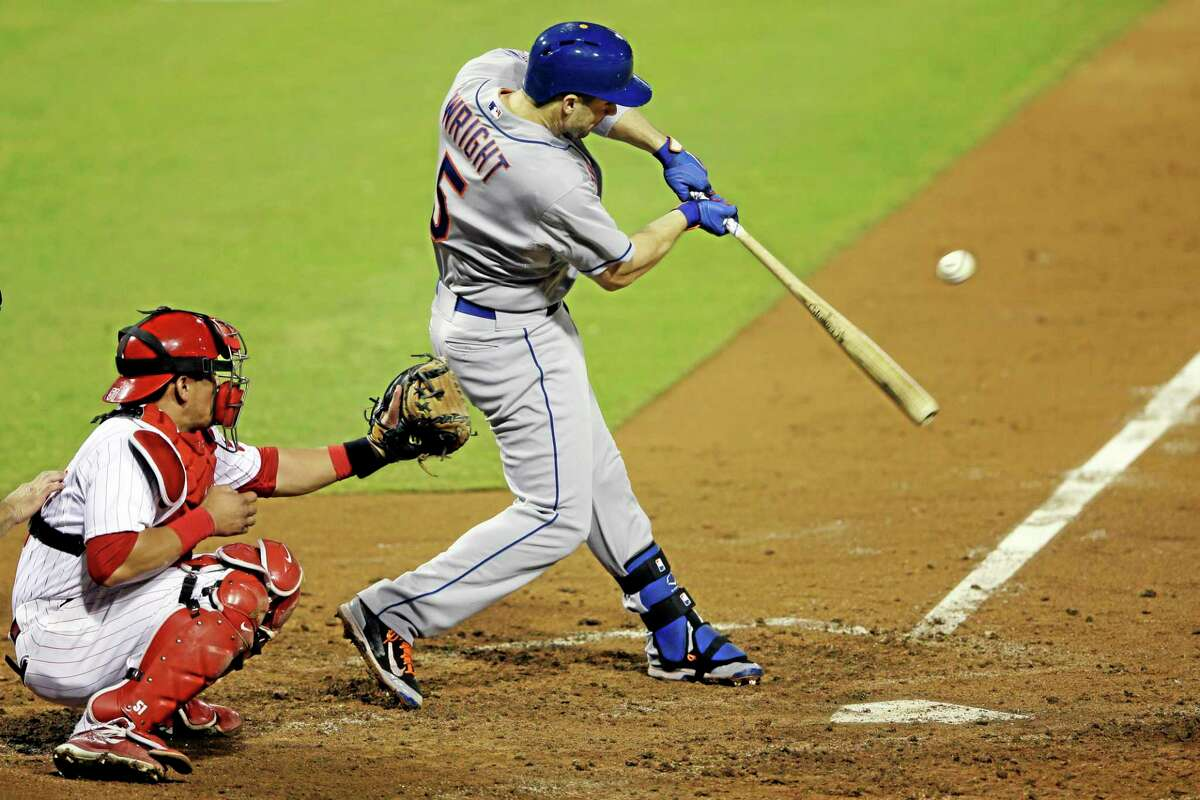 The Mets' David Wright, hits a single off Philadelphia Phillies starting pitcher Cole Hamels during the seventh inning of Friday's game.