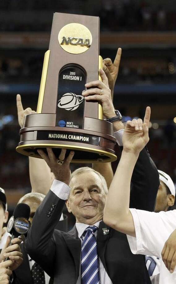 Connecticut head coach Jim Calhoun holds the championship trophy after his team won the men's NCAA Final Four college basketball championship game against Butler  53-41 Monday, April 4, 2011, in Houston. (AP Photo/David J. Phillip) Photo: AP / AP2011