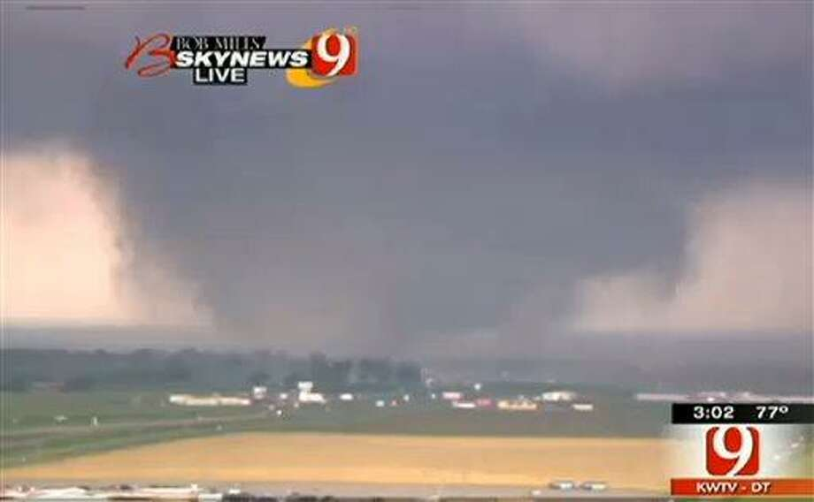 This frame grab provided by KWTV shows a tornado in Oklahoma City Monday, May 20, 2013. Television footage shows flattened buildings and fires after a mile-wide tornado moved through the Oklahoma City area. (AP Photo/Courtesy KWTV) Photo: AP / KWTV Oklahoma City