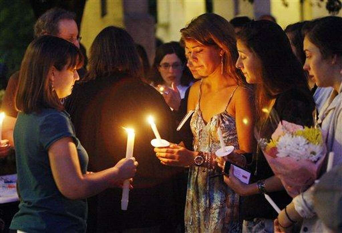Boston University students including Tori Pinheiro, third right, of New Bedford, Mass., and Austin Brashears' girlfriend, holds a candlelight vigil Saturday on Marsh Plaza at Boston University in Boston, for three students studying in New Zealand who were killed when their minivan crashed during a weekend trip. Associated Press