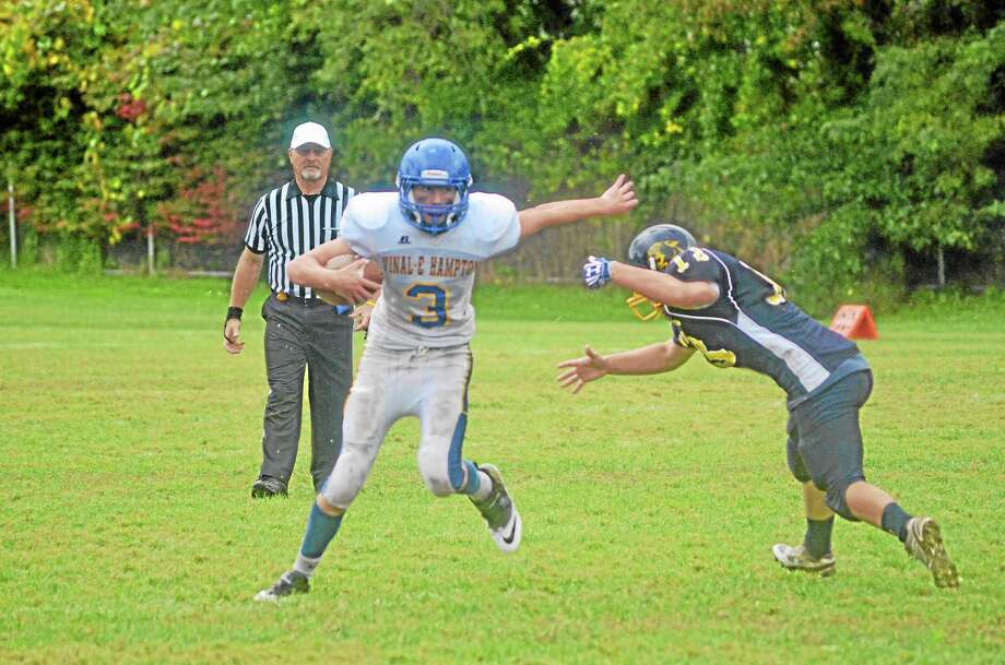 Vinal Tech/East Hampton's Austin Mann sheds off a Wolcott Tech defender in the Hawks 19-12 win over Wolcott Tech. Photo: John Berry — Register Citizen