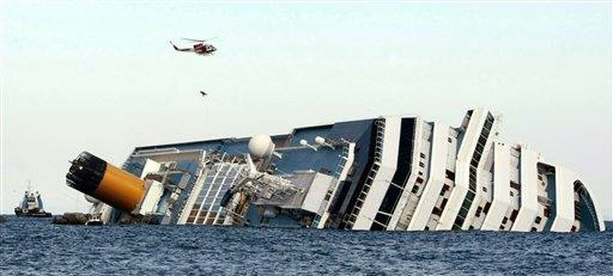 An Italian firefighter helicopter lifts a rescued passenger from the luxury cruise ship Costa Concordia which ran aground off the tiny Tuscan island of Giglio, Italy, Sunday. Firefighters worked Sunday to rescue a crew member with a suspected broken leg from the overturned hulk of the cruise liner, 36 hours after it ran aground. Associated Press