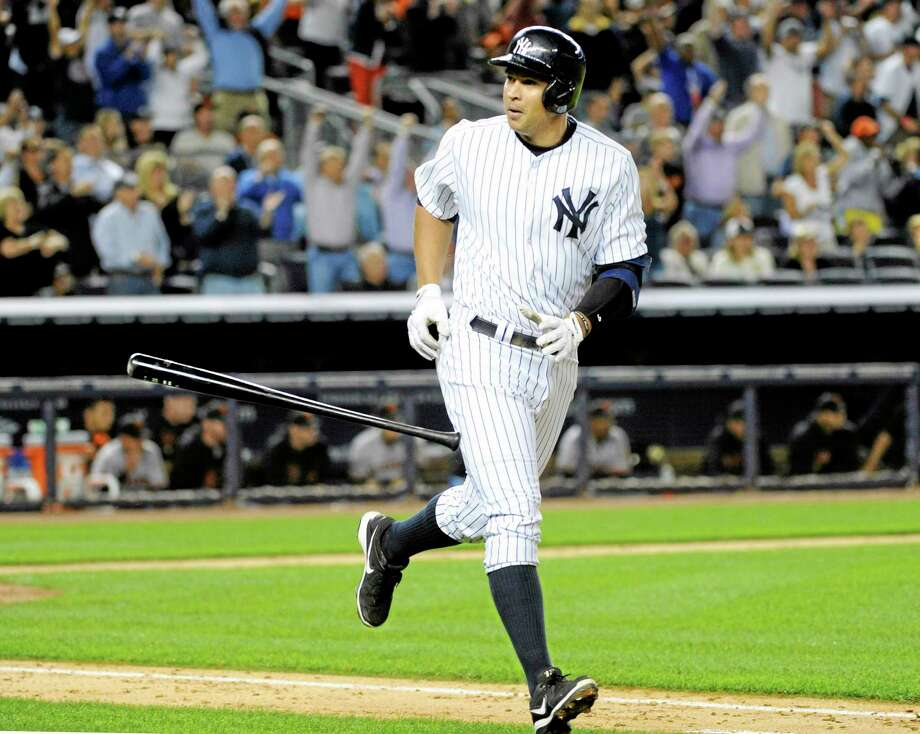 The Yankees' Alex Rodriguez flips his bat after hitting a grand slam during the seventh inning of Friday's game with the Giants. Photo: Bill Kostroun — The Associated Press  / FR51951 AP