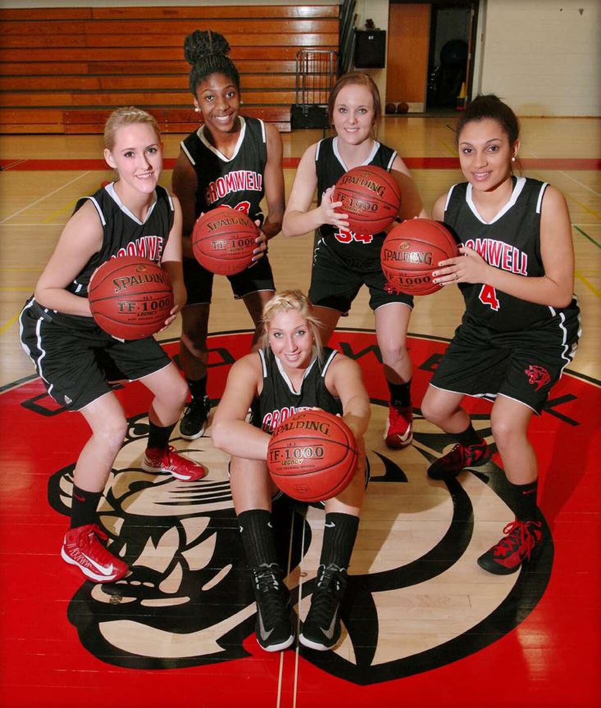 Catherine Avalone/The Middletown Press The starting five for unbeaten Cromwell girls basketball: (front row) Lindsay Langenauer and (back row, left to right) Emily Appleby, Janelle Harrison, Kelly Flanigan and Alexa Riley. Cromwell (13-0) plays at Old Saybrook Friday at 7.