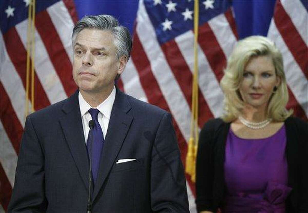 Republican presidential candidate, former Utah Gov. Jon Huntsman, stands with his wife Mary Kaye Huntsman as he announces he is ending his campaign in Myrtle Beach, S.C., Monday. Associated Press