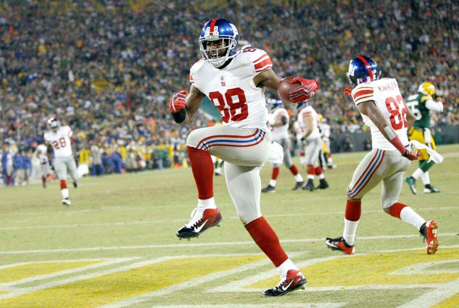 New York Giants wide receiver Hakeem Nicks (88) celebrates after catching a 37-yard touchdown pass during the first the first half of an NFL divisional playoff football game against the Green Bay Packers Sunday, Jan. 15, 2012, in Green Bay, Wis. (AP Photo/Mike Roemer) Photo: AP / AP2012
