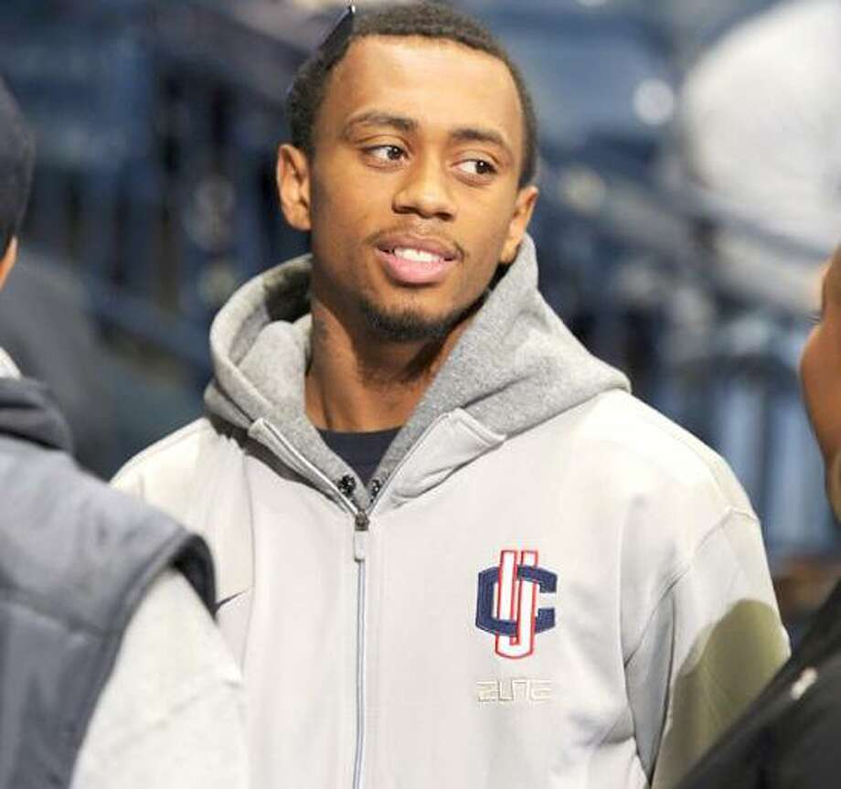 Connecticut guard Ryan Boatright talks with friends prior to the first half of an NCAA college basketball game with Notre Dame, Saturday, Jan. 14, 2012, in South Bend, Ind. Connecticut has benched freshman guard Ryan Boatright for the second time this season as the NCAA investigates his eligibility. The school announced Friday night that Boatright will not play today at Notre Dame and will remain inactive while the school works with the NCAA during its review.(AP Photo/Joe Raymond) Photo: AP / Joe R. Raymond