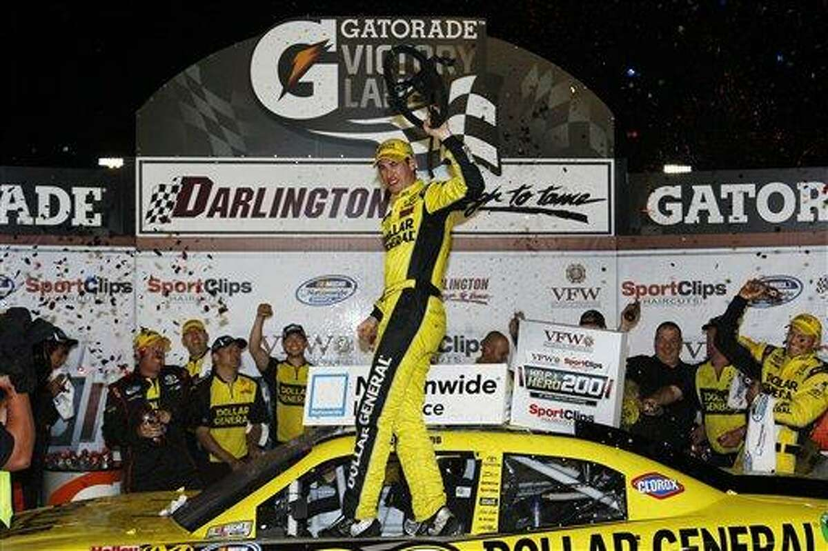 Joey Logano celebrates in victory lane after winning the NASCAR Nationwide Series auto race at Darlington Raceway, Friday, May 11, 2012, in Darlington, S.C. (AP Photo/LAT, Lesley Ann Miller) MANDATORY CREDIT