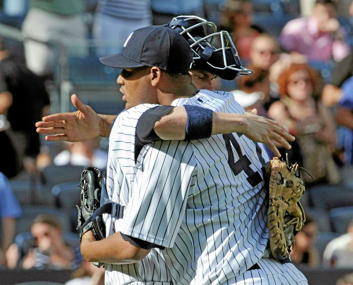 Yankees pitcher Ivan Nova hugs catcher Chris Stewart after pitching a complete-game shutout in New York's 6-0 win over the San Francisco Giants on Saturday afternoon at Yankee Stadium.