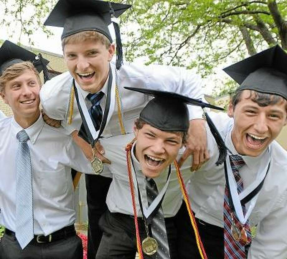 Members of Xavier's class of 2013, Adam Boyington, of Haddam, Middletown residents Corey Danko, Gavin Clemmey, school president, and Hamden resident Zac Camner celebrate after receiving their diplomas at the Forty-seventh Commencement Sunday morning. All are members of Xavier's Ultimate Frisbee team. Catherine Avalone/The Middletown Press / TheMiddletownPress
