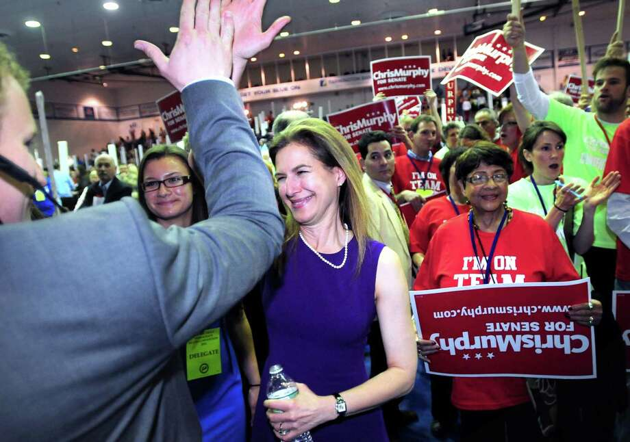 Susan Bysiewicz high-fives her campaign manager, Johathan Ducote, after hearing the results for the nomination to the U.S. Senate race at the Connecticut Democrats 2012 State Convention at Central Connecticut State University in New Britain. Arnold Gold/New Haven Register
