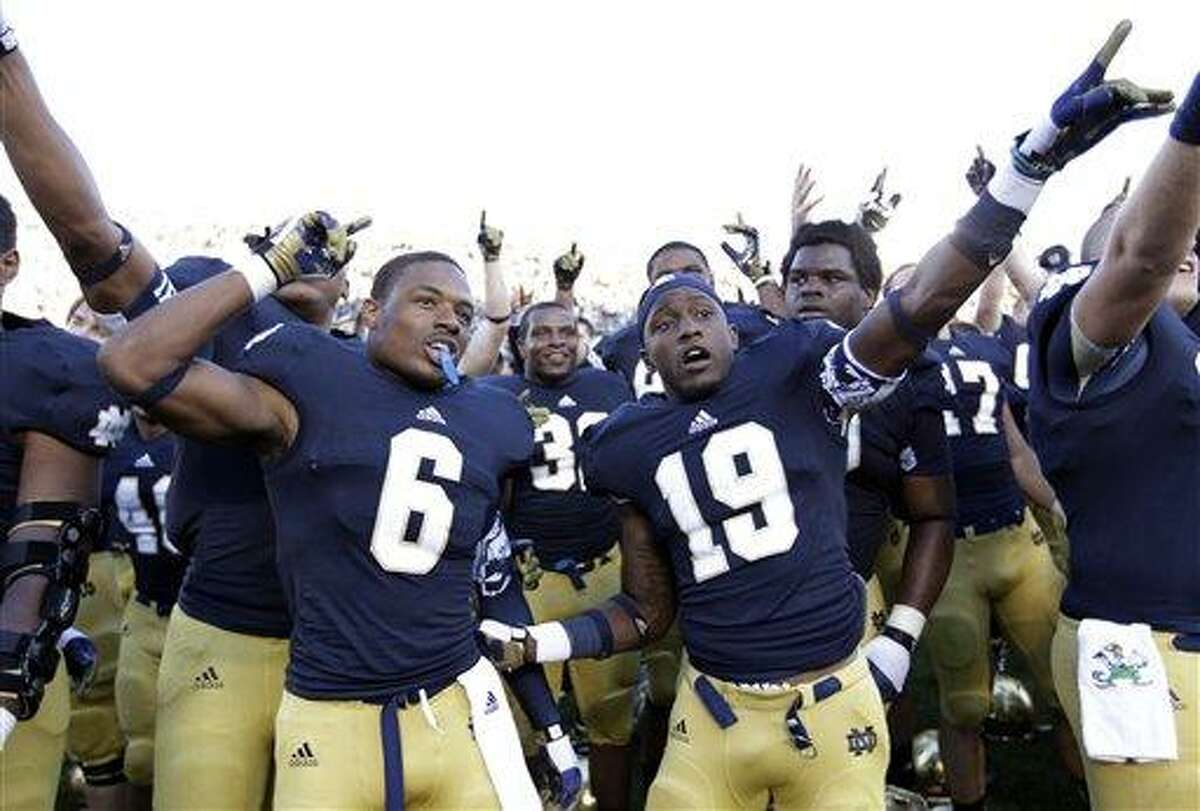 Notre Dame cornerback KeiVarae Russell (6) and wide receiver Davonte' Neal (19) celebrate following an NCAA college football game against Purdue in South Bend, Ind., Saturday, Sept. 8, 2012. Notre Dame defeated Purdue 20-17. (AP Photo/Michael Conroy)