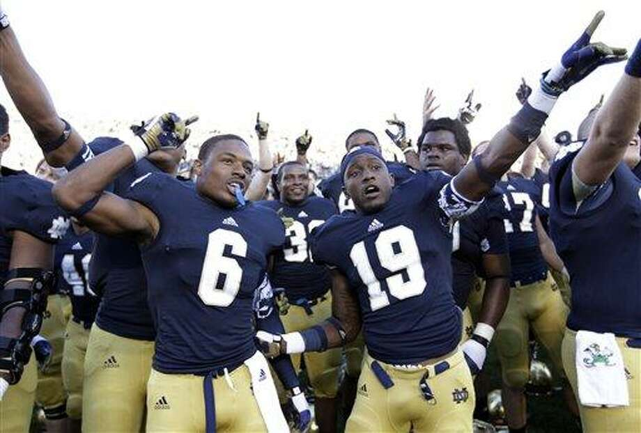 Notre Dame cornerback KeiVarae Russell (6) and wide receiver Davonte' Neal (19) celebrate following an NCAA college football game against Purdue in South Bend, Ind., Saturday, Sept. 8, 2012. Notre Dame defeated Purdue 20-17. (AP Photo/Michael Conroy) Photo: AP / AP