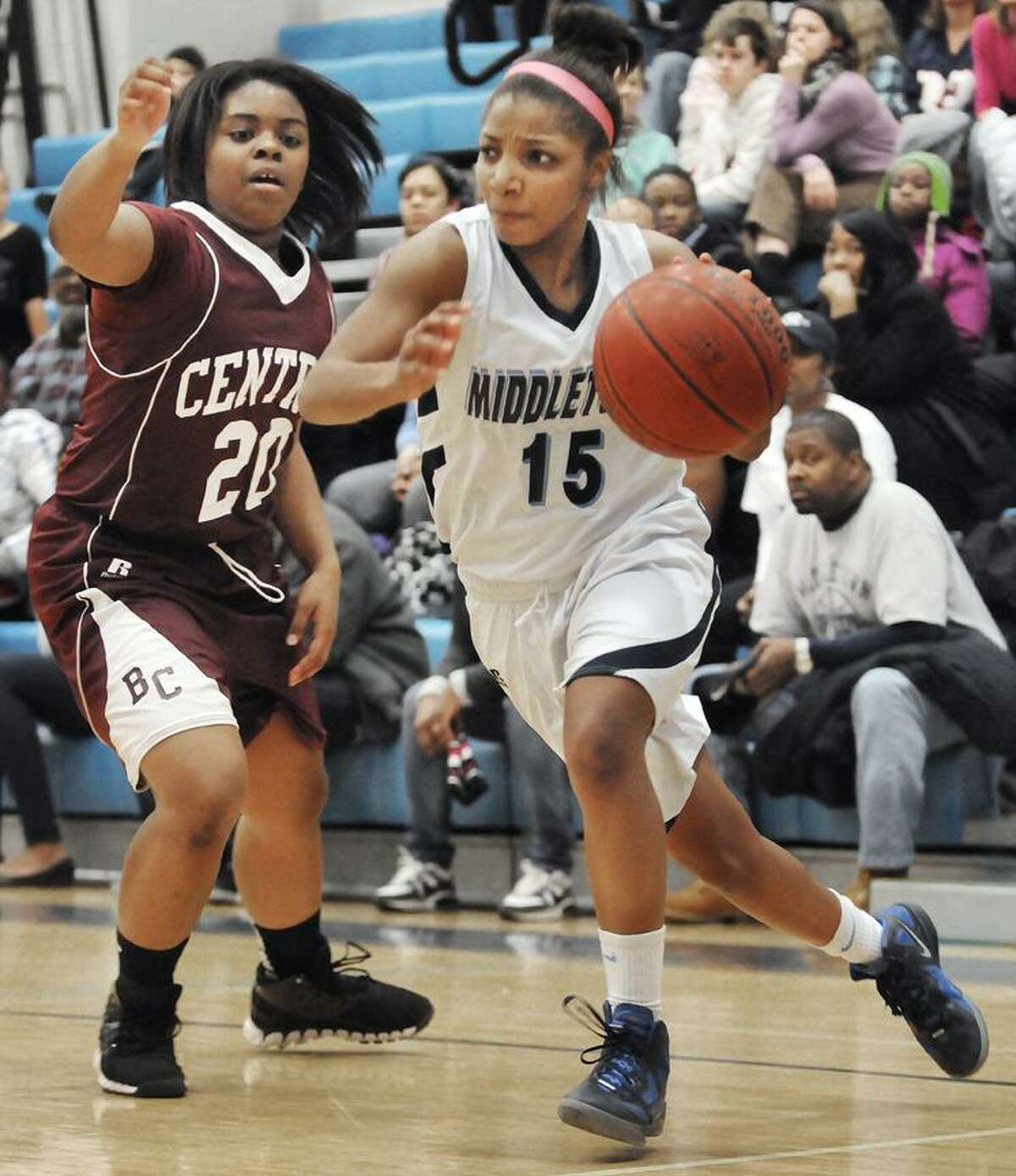 The Middletown Press 1.13.12 Middletown's Tamyia King battles under the boards against Bristol Central's Tyra Talbit # and Chandler Walker #30 Friday night. The Blue Dragons defeated Briston Central 50-36.