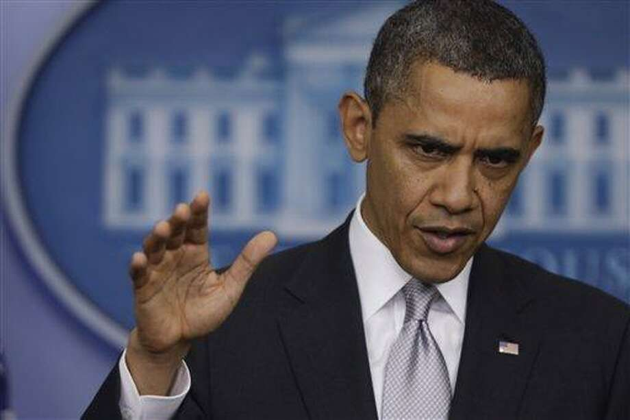 President Barack Obama gestures as he answers a question about the fiscal cliff from reporters, Wednesday, Dec. 19, 2012, at the White House in Washington. (AP Photo/Charles Dharapak) Photo: AP / AP