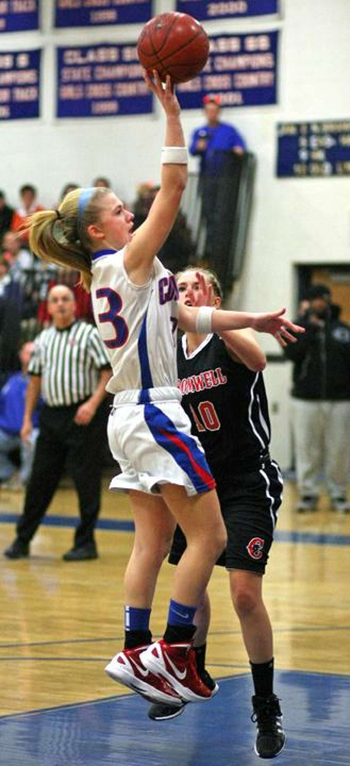 Special to the Press 01.13.12 Cromwell's Lindsay Langenauer battles Coginchaug's Morgan Kuehnle in Friday's basketball game. Coginchaug won. To buy a glossy print of this photo and more, visit www.middletownpress.com.