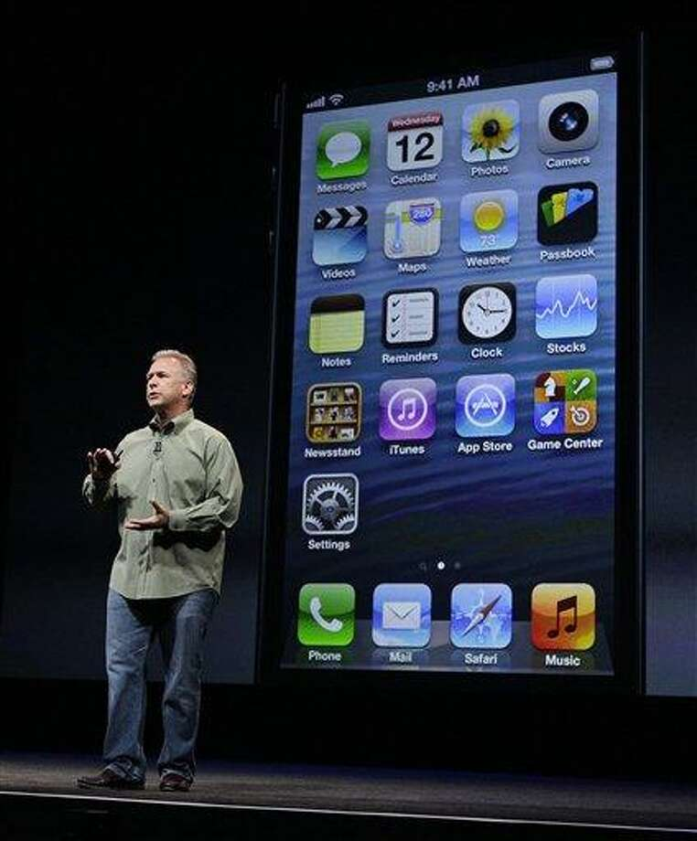 Phil Schiller, Apple's senior vice president of worldwide marketing, speaks on stage during an introduction of the new iPhone 5 Wednesday at an Apple event in San Francisco. Associated Press Photo: AP / AP