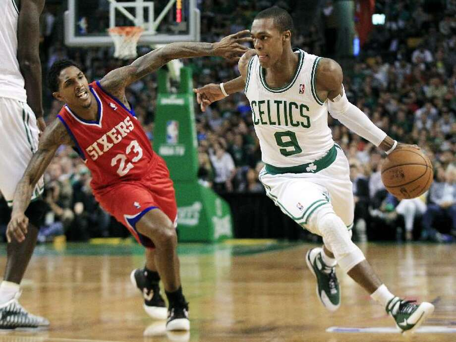 ASSOCIATED PRESS Boston Celtics guard Rajon Rondo (9) drives by Philadelphia 76ers guard Lou Williams (23) during the first quarter of Game 1 of their Eastern Conference semifinal playoff series Saturday in Boston. The Celtics won 92-91.